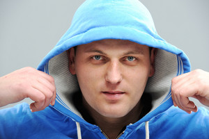 Young man wearing hooded sweatshirt