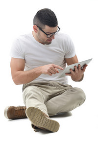 Young man with glasses holding a tablet computer