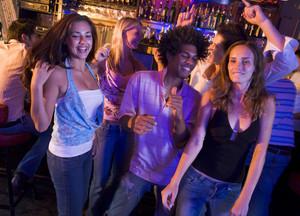 Young men and women dancing in a nightclub