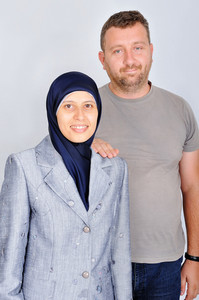 Young muslim couple, standing, isolated, studio