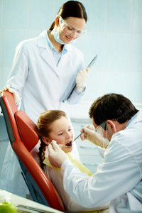 Young patient undergoing usual check-up procedure at dentist's