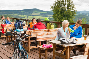 Young people relax mountain holiday summer sport drinking and eating