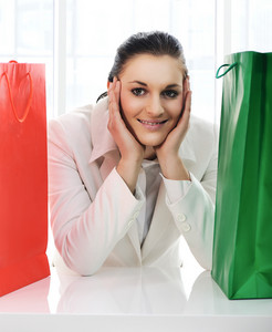 Young pretty woman with shopping bags with copy space