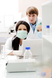 Young science workers research at medical lab