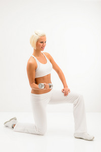 Young sportive woman strenghten triceps with dumbbells on white background