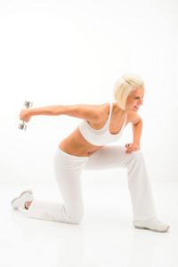Young sportive woman strengthen triceps with dumbbells on white background