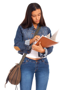 Young Student Reviewing Her Textbook