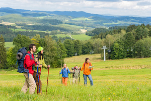 Young trekking people enjoying nature and scenic landscape