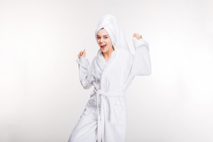 young woman in bathrobe with towel on her head