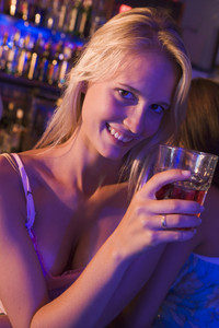Young woman in nightclub smiling at camera