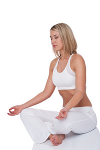Young woman in yoga position on white background