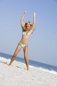 Young woman on beach holiday wearing bikini