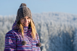 Young woman portrait winter mountains snow smiling sunny countryside