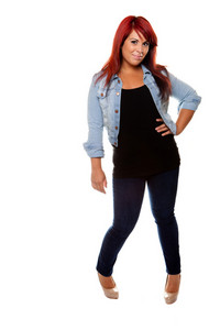Young woman proudly shows off her physique wearing jeans over a white background.