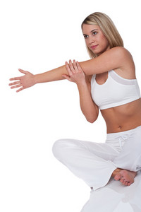 Young woman stretching on white background