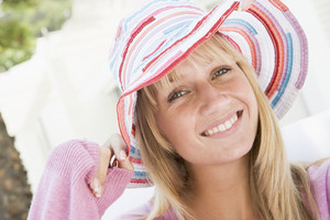 Young woman wearing colourful straw hat