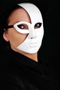 Young woman with black and white mask