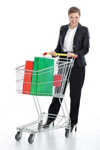Young woman with shopping cart isolated