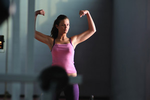 Young woman with strong arms