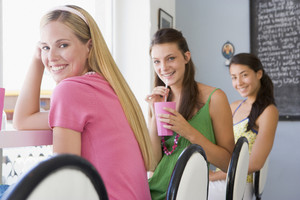 Young women drinking milkshakes in a cafe