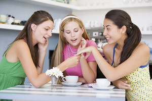 Young women enjoy tea in a cafe