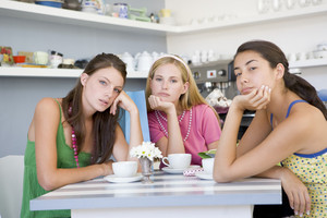 Young women having tea in a cafe