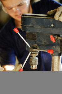 Young worker working in workshop