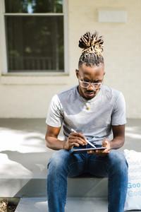 African American black man using tablet