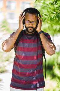 African American man listening to music with headphones