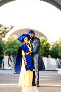 african couple wearing traditional clothing embrace one another