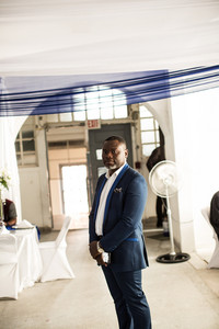 African man at standing at a venue