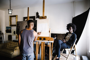 African man sketching a portrait