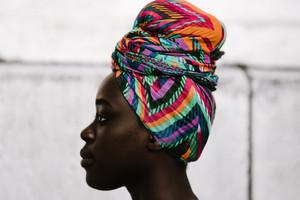 African model wearing a multicolored headwrap