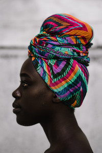 African woman wearing a multicolored headwrap