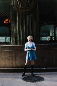 Albino woman standing near subway