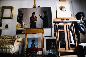 An artist's studio, with model