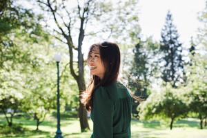 asain woman smiling in nature