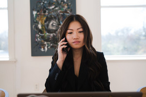 Asian woman taking a business phone call