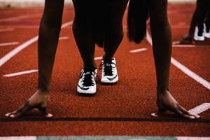 athlete prepares to run on a track