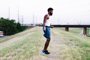 athletic man exercising with a jumprope outside