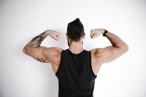 athletic man flexes his arms