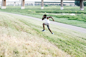 athletic man performing hill sprints