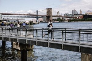 athletic man works out on dock
