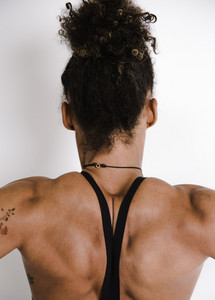 athletic woman reveals her muscular build