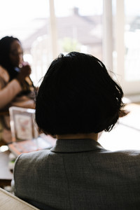 back of person's head with short black hair
