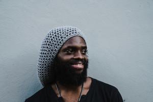 bearded black man smiling