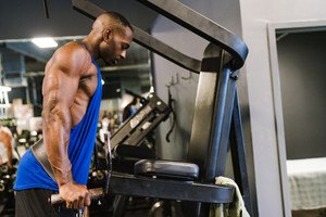 Black, African American man working out at the gym.