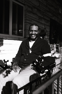 Black and white photo of a man in a wheelchair