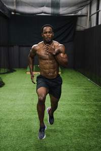 black athlete running on grass