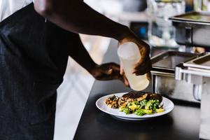 black chef preparing ethnic dish